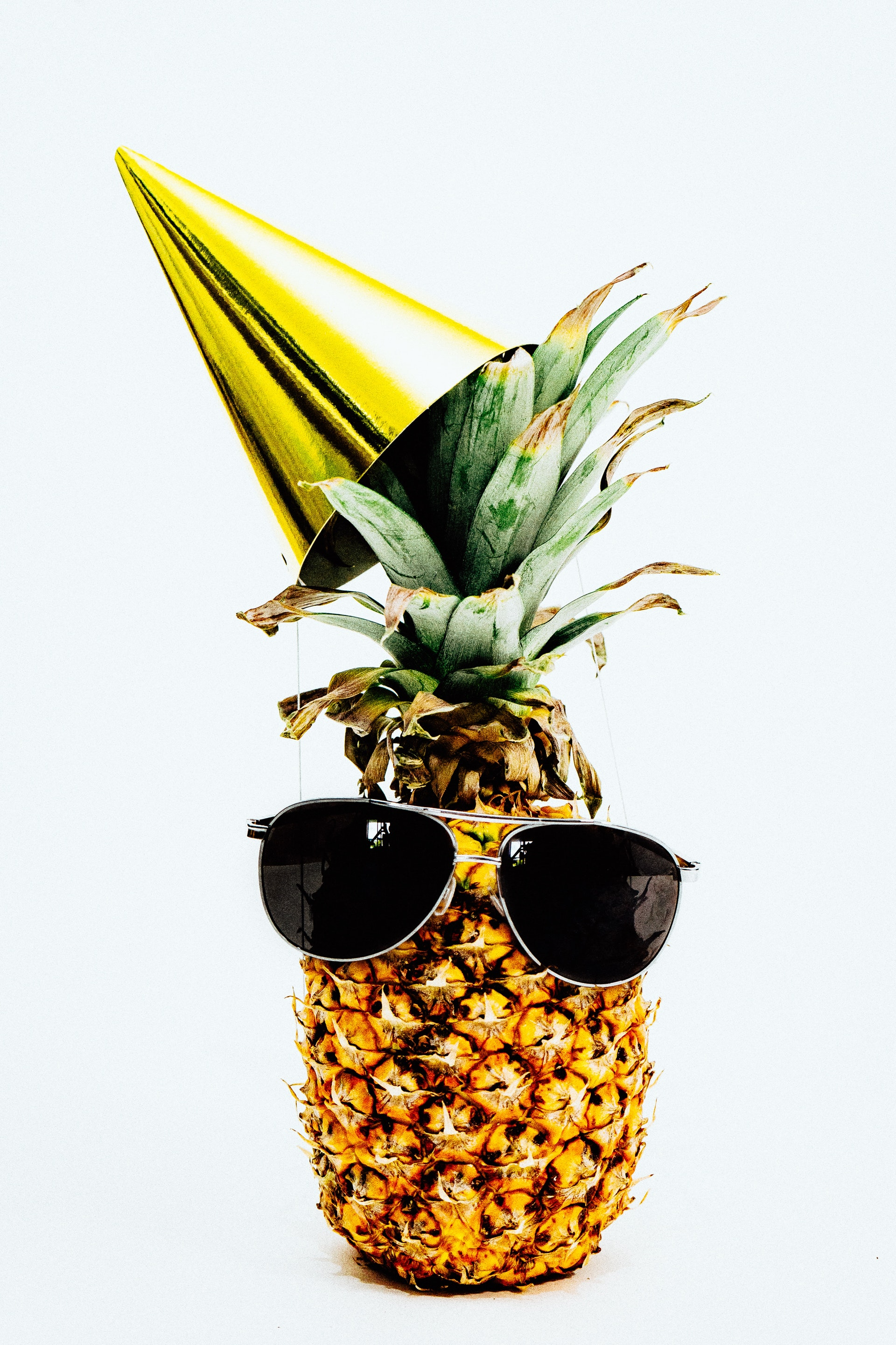 https://www.pexels.com/photo/photo-of-pineapple-wearing-black-aviator-style-sunglasses-and-party-hat-1071878/